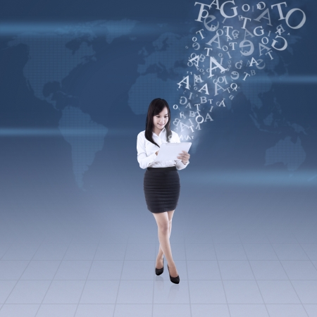 Businesswoman using electronic tablet for global communication photo