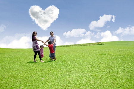 family holidays: Happy family enjoying valentine