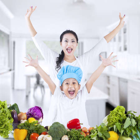 Happy family with vegetable at home Stock Photo - 18960838