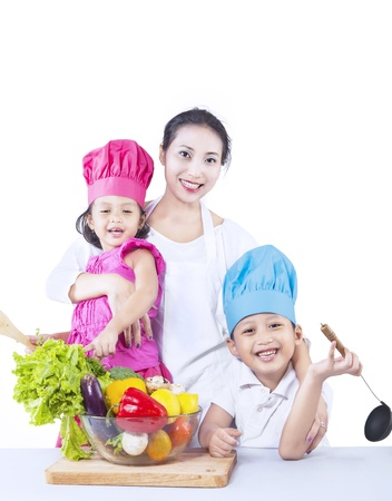 Happy family with vegetable on white background photo