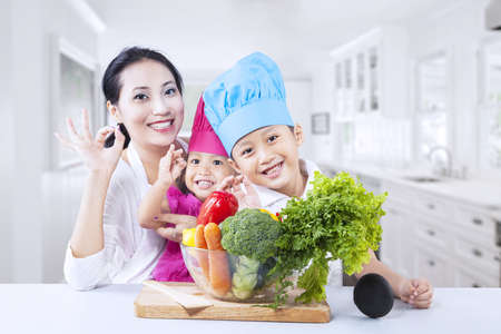 Happy family with vegetable at home photo