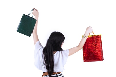 Excited woman carry two shopping bags on white background Stock Photo - 19114414