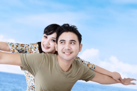 Girlfriend enjoy piggyback ride photo