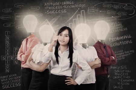 Business manager and team with light bulb heads Stock Photo - 19164615