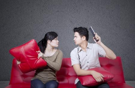 Couple fight on black background photo