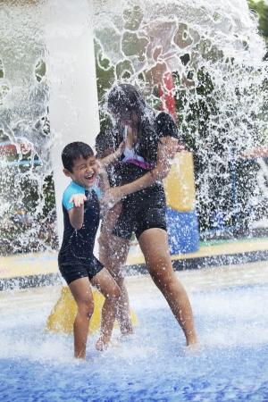 indonesian: Family having fun in water park