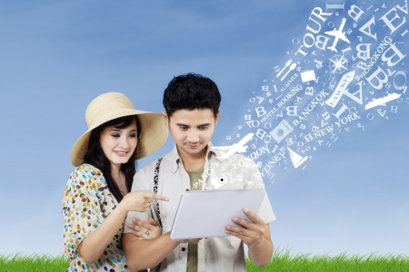 honeymoon couple: Arrange honeymoon travel from electronic tablet