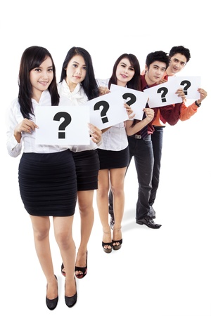 Business people holding question marks board during recruitment process photo