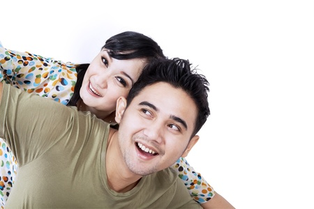 Girlfriend enjoying piggyback ride on boyfriend Stock Photo - 19225731