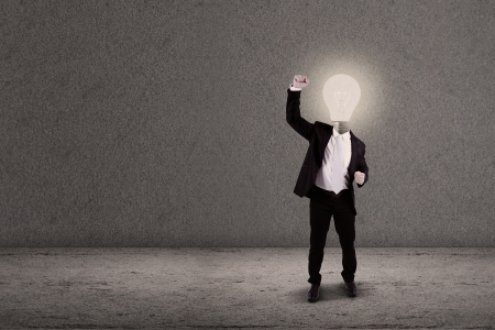 Man Businessman showing OK sign with head made of light bulb Stock Photo - 19225735