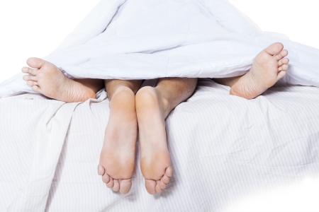 Close-up of couple's feet having intimate relation in bed Stock Photo - 19274674