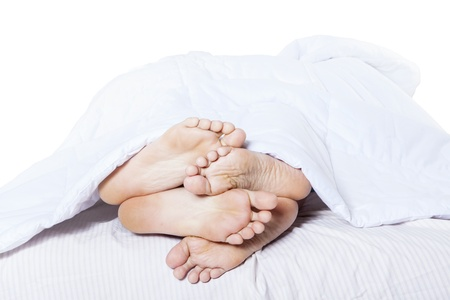 woman sex: Close-up of couples feet cuddling Stock Photo
