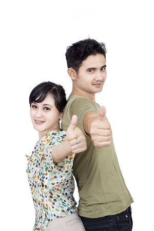 Couple thumbs up on white background photo