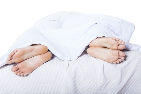 bed sex: Close-up of couples feet who had a fight on bed Stock Photo
