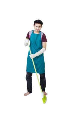 Full body of man with broom on white background photo