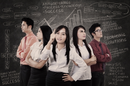 intelligent solutions: Businesswoman leads a strong team in the class