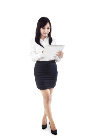 Businesswoman holding electronic tablet isolated in white Stock Photo - 19317655