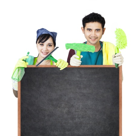 Cleaning service couple holding blackboard photo
