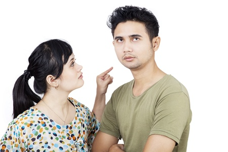 woman shouting: Angry girlfriend pointing at boyfriend on white background