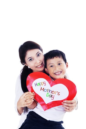 Asian mother and son holding love card, isolated on white photo