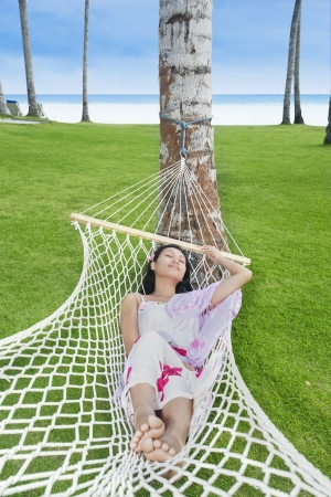 Attractive woman relaxing in Bali resort beach, Indonesia Stock Photo - 19425703