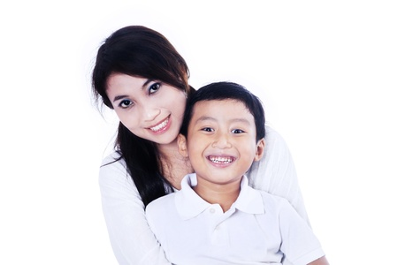 Beautiful mother and her son on white background photo