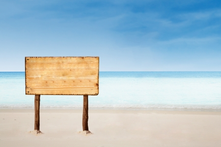 Empty sign board with copy space on a beautiful beach photo