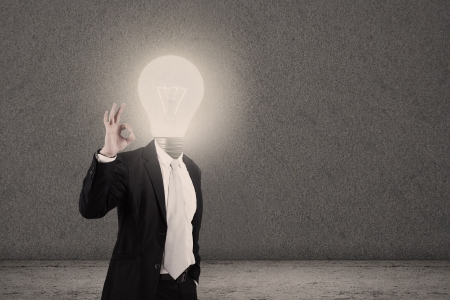 patent: Businessman with light bulb head showing OK sign Stock Photo