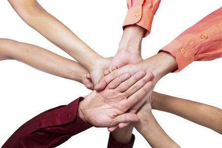 Close-up of business people joining their hands on white background Stock Photo - 19576005