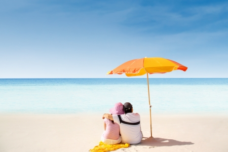 whitsunday: A couple relaxing on the beach in Whitsunday island Stock Photo