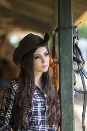 Beautiful girl at horse ranch photo