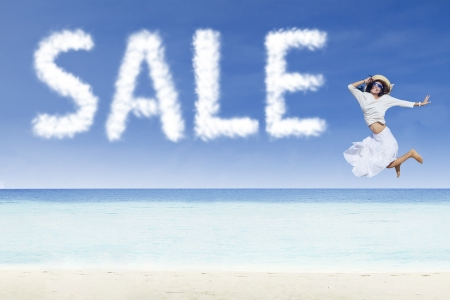 discounted: Young girl jumping and sale cloud on white sand beach