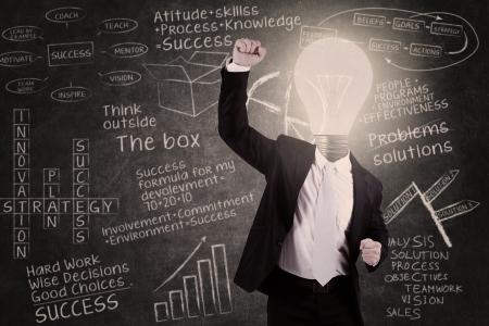 light classroom: Businessman with lightbulb head raised hand