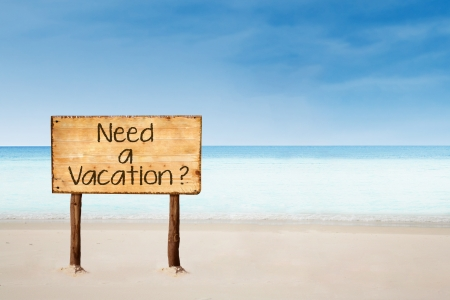 Sign of Need a Vacation  on the beach in Australia photo