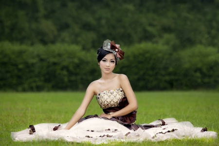 nude girl sitting: Attractive lady in formal  gown at park