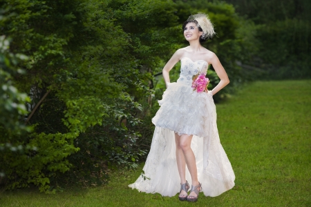 Beautiful bride in white gown at park photo