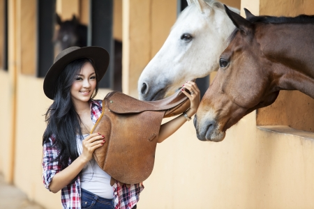 girl on horse: Beautiful woman rider at horse ranch