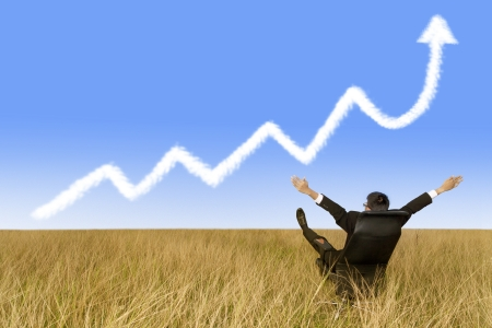 Success businessman and growth graph cloud photo