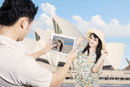 Couple take picture in Sydney Australia photo