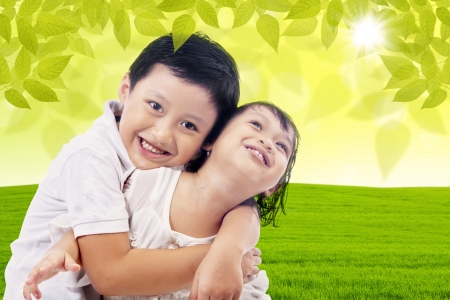 love kiss: Loving brother hugging her sister at the park Stock Photo