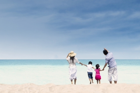 Happy family at whitehave beach, Australia photo