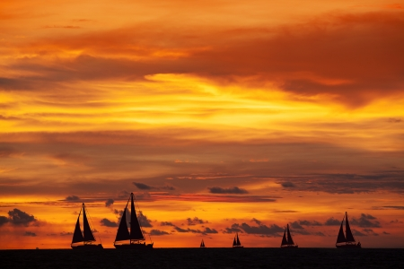 Beautiful view of sunset and silhouette of ships on ocean Imagens