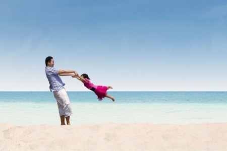 clear day: Father and daughter happy time at beach Stock Photo