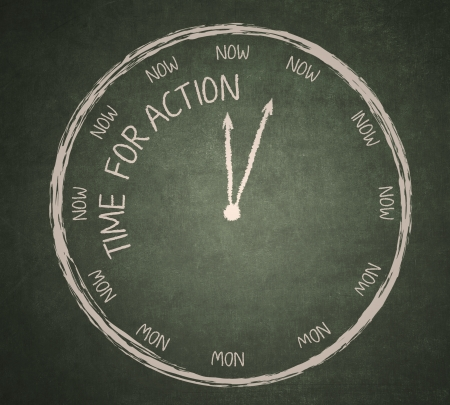 Time for Action written on the blackboard with clock photo