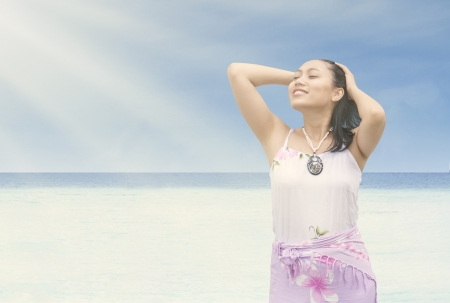 Beautiful Asian woman enjoying sunshine at the beach Stock Photo - 19722939