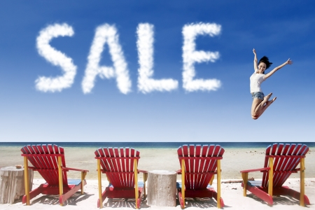 summer sale: Sale cloud over beach chairs with woman beside the word
