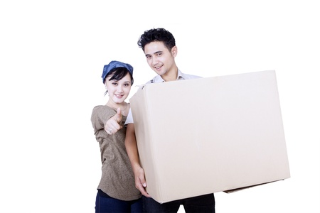 Asian couple carry a large box on white background photo