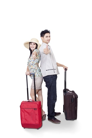 departures: Asian couple bring luggages on white background Stock Photo