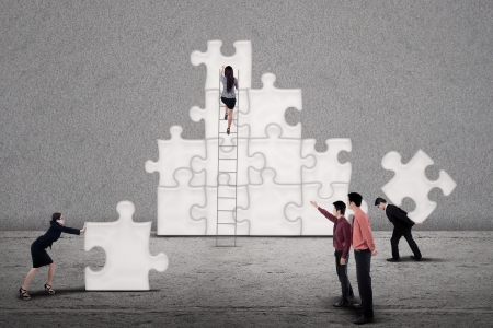 Business teamwork building puzzles together