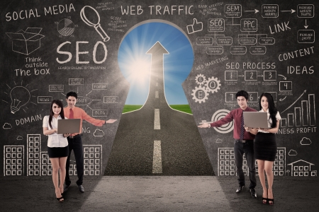 Business team present SEO success road concept through a keyhole Stock Photo - 19837053